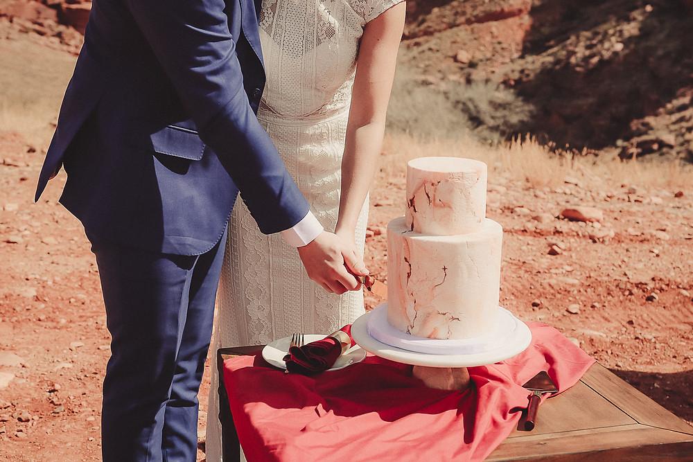 Moab Utah elopement bride and groom elope desert scenery Colorado photographer cake cutting