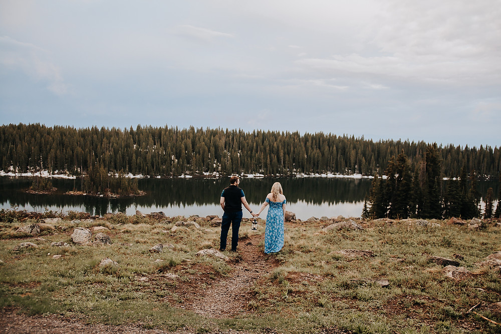 Colorado mountains engagement photos rainy day Grand Mesa lantern