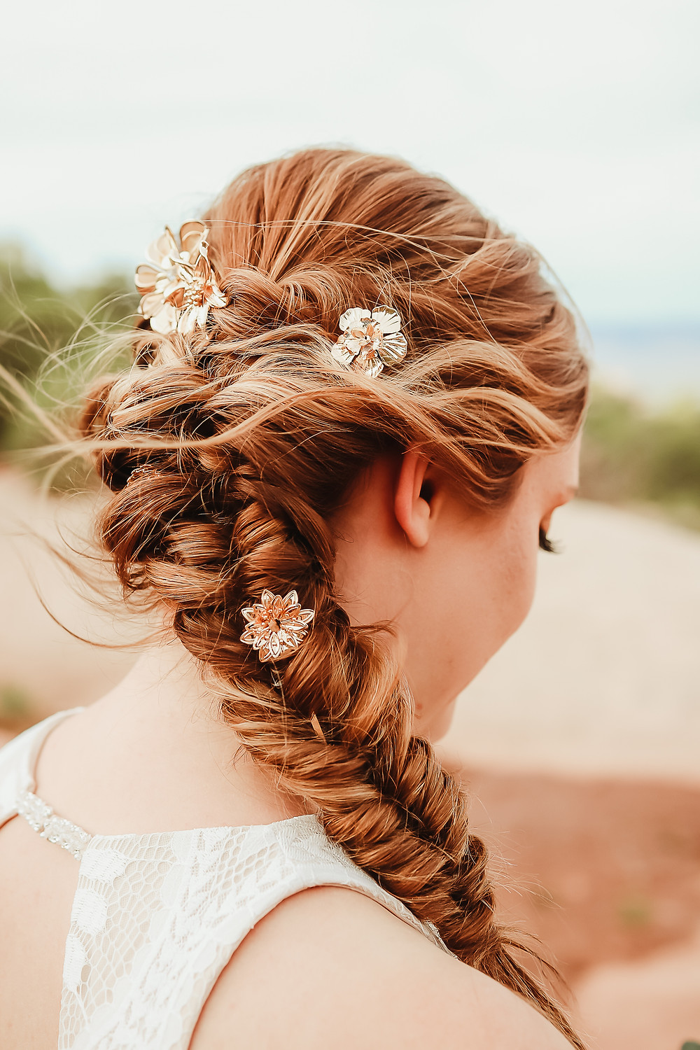Colorado National Monument intimate elopement bride and groom elope desert scenery Bookcliff Overlook bride hair detail