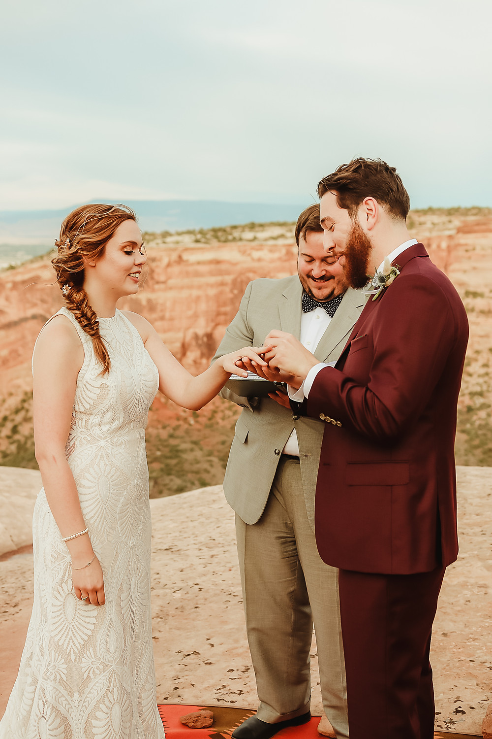 Colorado National Monument intimate elopement bride and groom elope desert scenery Bookcliff Overlook ceremony