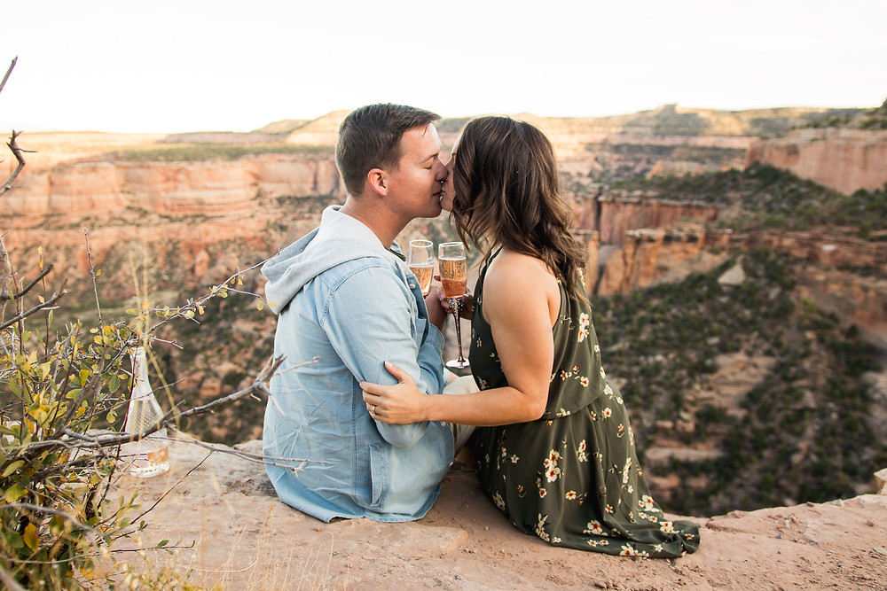 Colorado National Monument champagne toast engagement couple kisses
