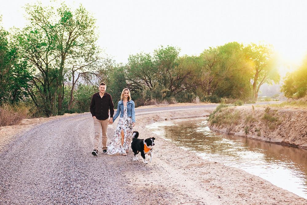 Palisade Colorado vineyard engagement photos with dog sunrise