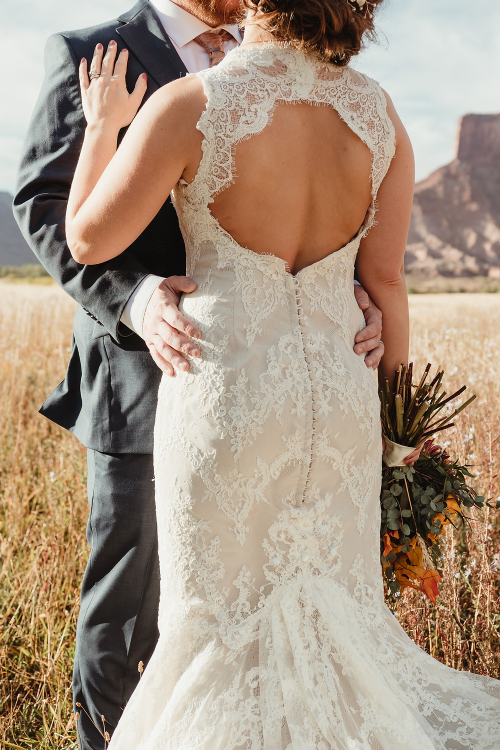 Gateway Canyons Resort Colorado elopement ceremony intimate bride and groom kiss red rock canyon