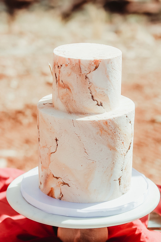 Moab Utah elopement bride and groom elope desert scenery Colorado photographer cake detail