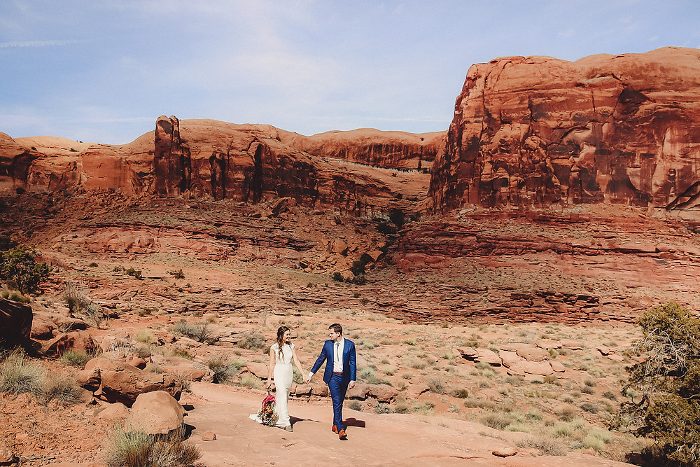 Moab Utah red rock canyon elopement beautiful scenery couple holding hands Colorado photographer