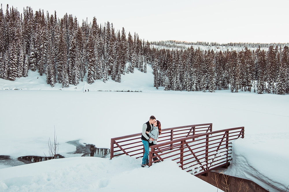 Snowy engagement session Colorado mountains winter trees Grand Mesa Lakes Lodge