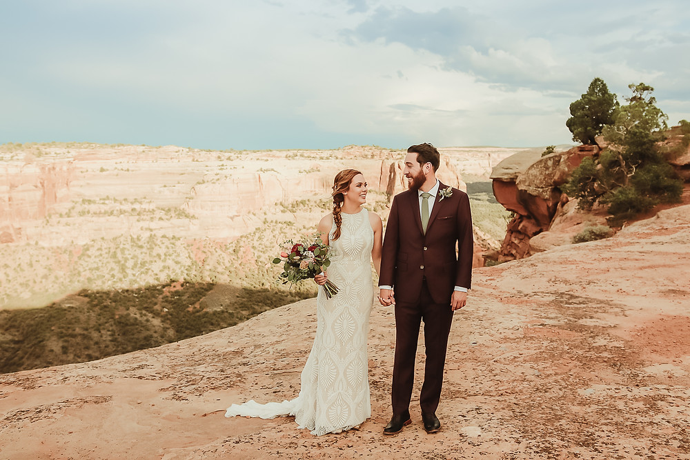 Colorado National Monument intimate elopement bride and groom elope desert scenery Bookcliff Overlook