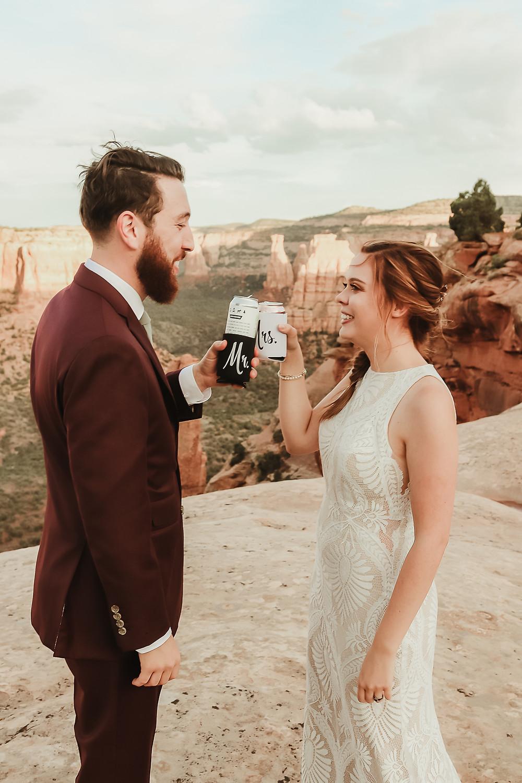 Colorado National Monument intimate elopement bride and groom elope desert scenery Bookcliff Overlook beer toast