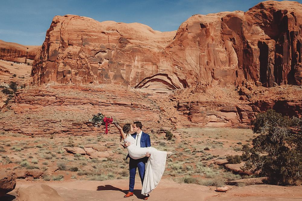 Moab Utah elopement bride and groom elope desert scenery Colorado photographer adventure elopement couple kisses