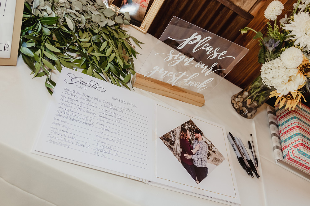 Guest book with engagement photos for guests to sign