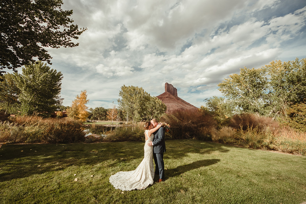 Gateway Canyons Resort Colorado elopement ceremony intimate bride and groom kiss