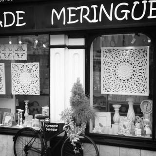 White wooden panel window display at Marmalade Meringue.
