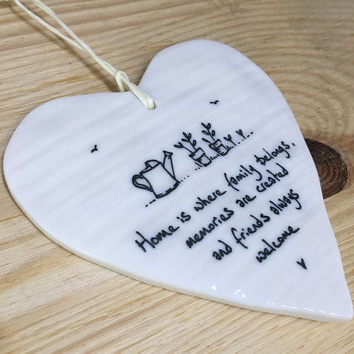 Home is where family belongs... hanging porcelain heart.