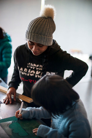 Artist Claudine Mailei facilitating an art workshop for young people at Te Oro.
