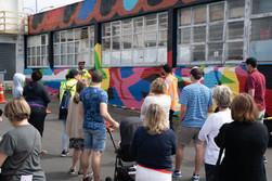 Street art tour by Street Artearoa stopping by artist Sean Anoma's mural.