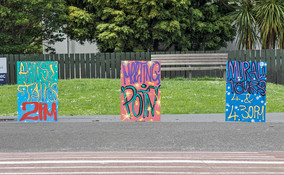 Hand-painted signs by Sean Anoma for the street art tours.