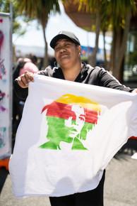Street art workshop outside Te Oro using stencils to create art.