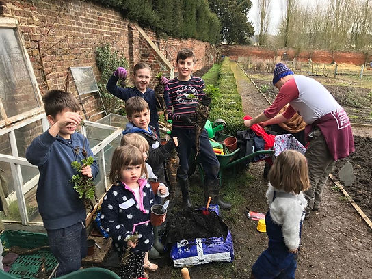 Boys and girls of varyious ages at a gardening workshop at The Walled Garden, Stanstead Abbots, Herts