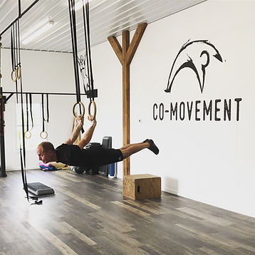 guy performing back lever at Co-movement gym in Oriskany Falls NY