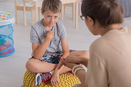 sad-young-boy-sitting-on-a-pouf-picture-