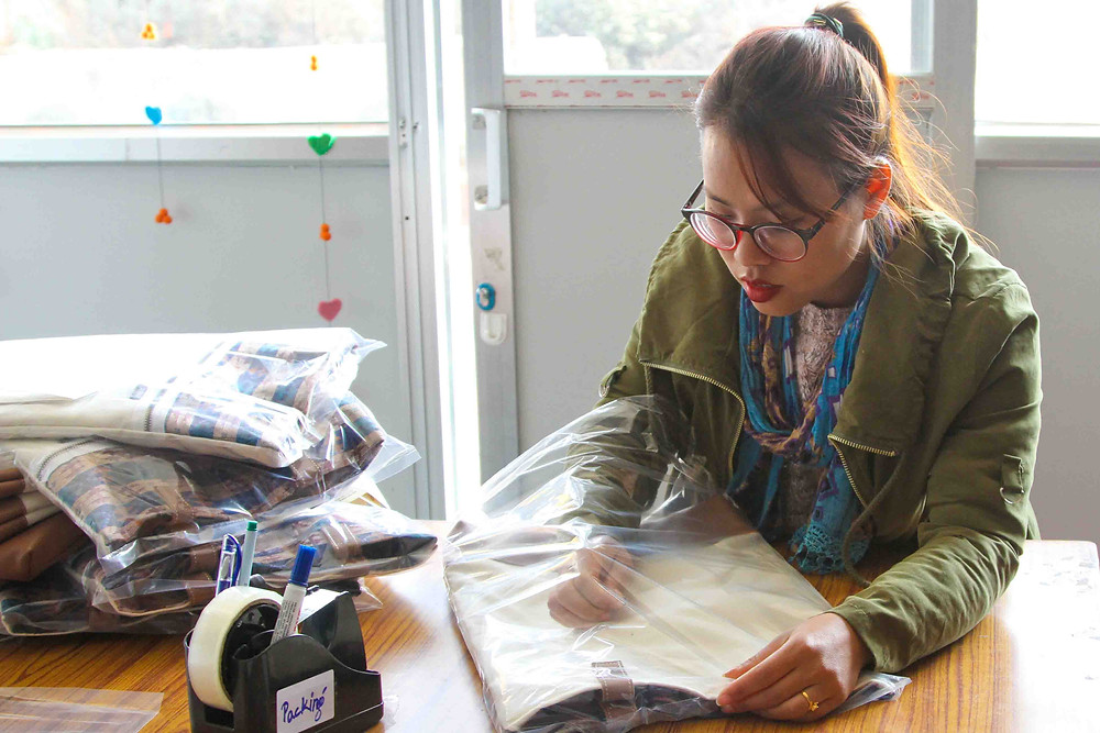 Purnaa packing ethical products for a brand