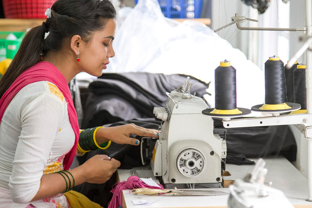Ethical manufacturing in Nepal. Empowered woman getting a fair wage