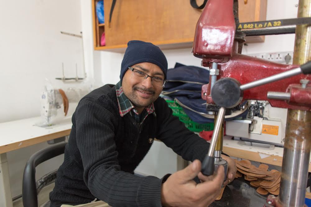 Purnaa staff working with machinery