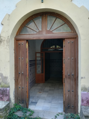 Main ornate entrance door to the front