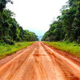 The road that cuts through otherwise pristine primary rainforest from Georgetown, Guyana to Lethem and eventually the border of Brazil.