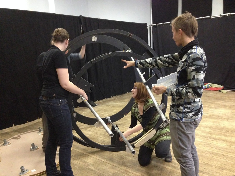 Members of the company reacquaint themselves with the intricacies of disassembling the set