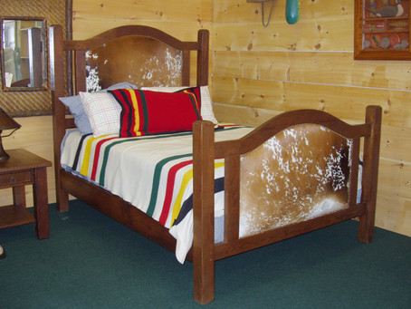 Cowhide and Heart Pine Bed
