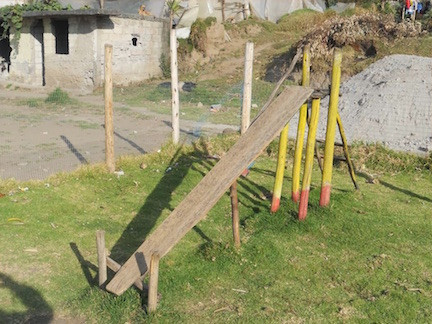 Playground Slide Made Of Wood With No Railings