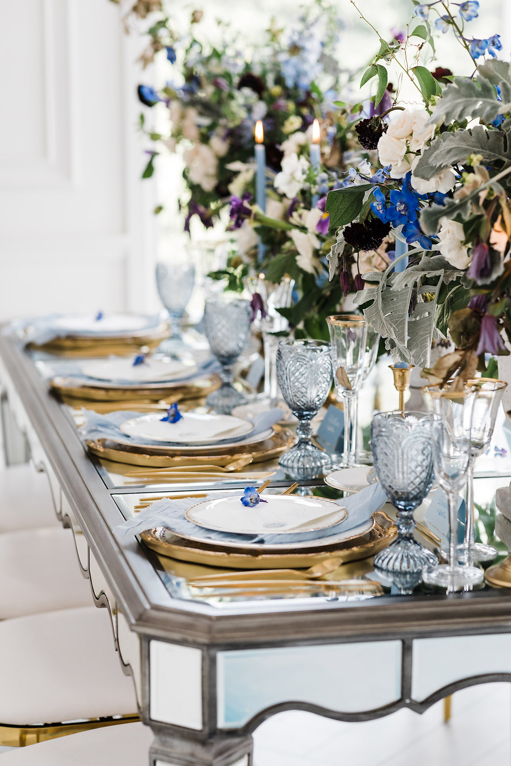 luxury toronto wedding inspiration blue flower reception decor plates candles