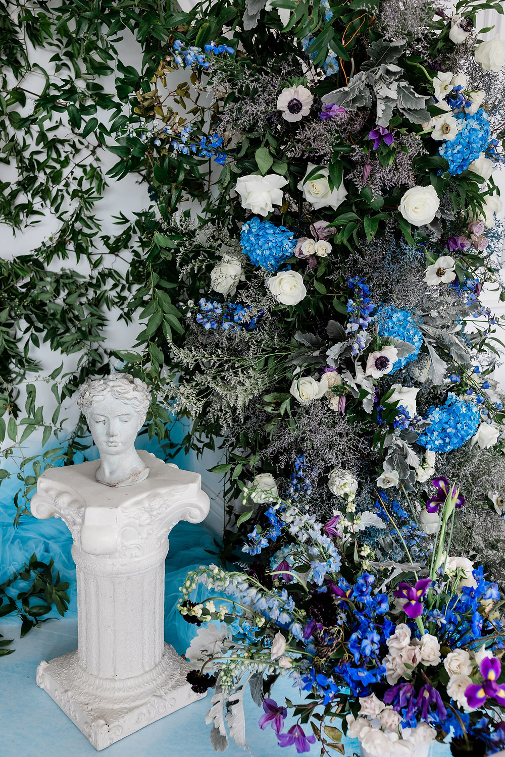 lush blue flower ceremony backdrop
