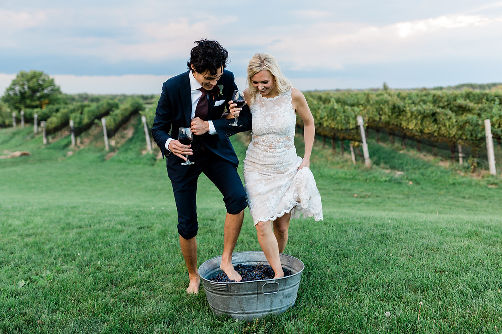 Wedding bride and groom wine stomping