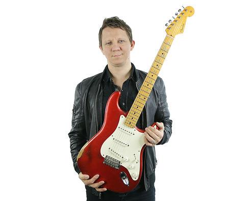 Roman with Guitar Website.jpg