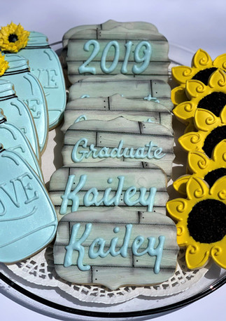 Handpiped Grad Cookies.KCB