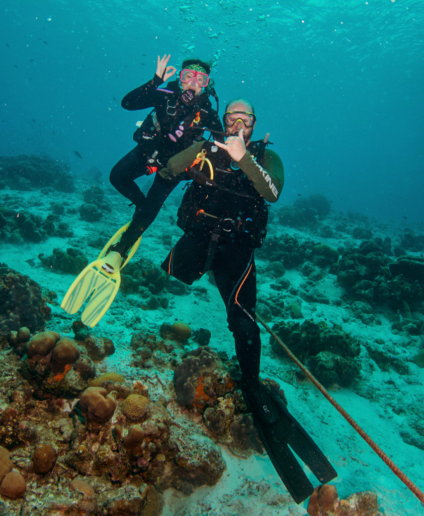 Valhalla Dive Group scuba diver with his certified adaptive dive buddy.