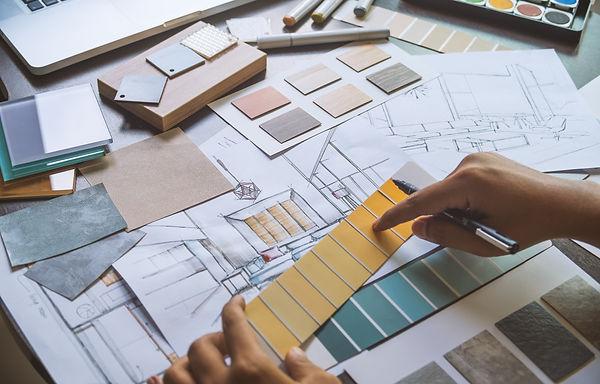 Architect designer Interior creative working hand drawing sketch plan blueprint selection