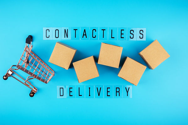 Contactless delivery concept, carboard box and shopping trolley on blue background.jpg