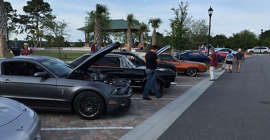 muscle cars with hoods popped open