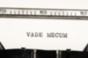 word vade mecum  typed on an old typewri