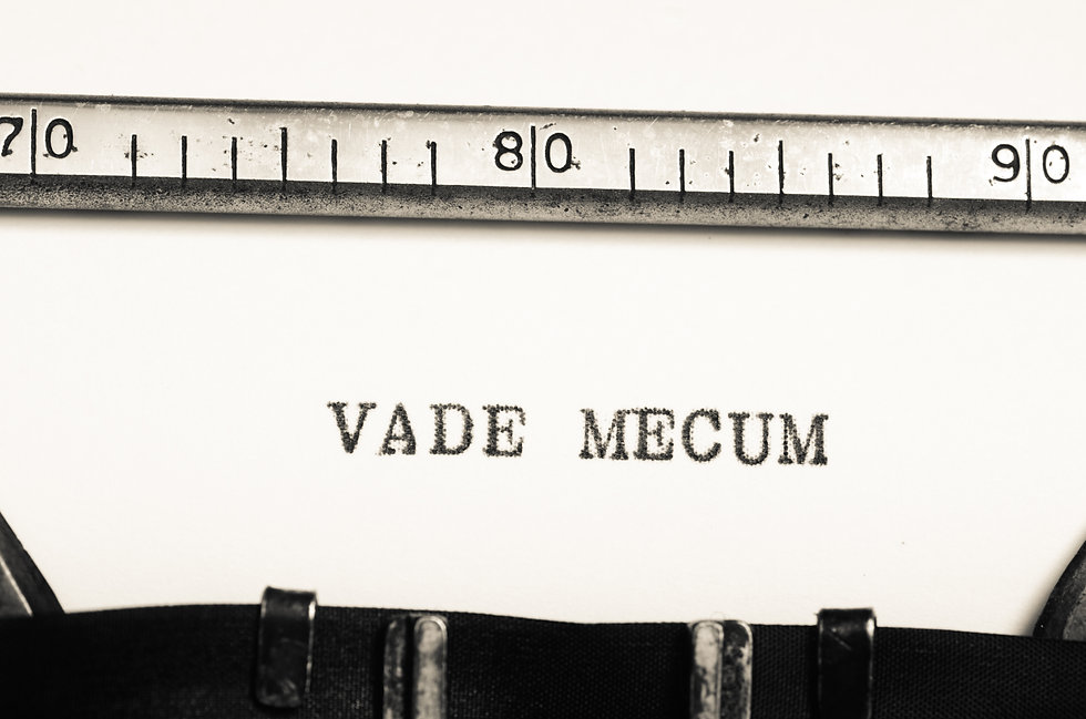word vade mecum  typed on an old typewri