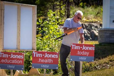 Dad putting up signs
