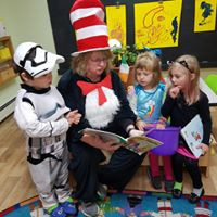 Lorilee reading to children