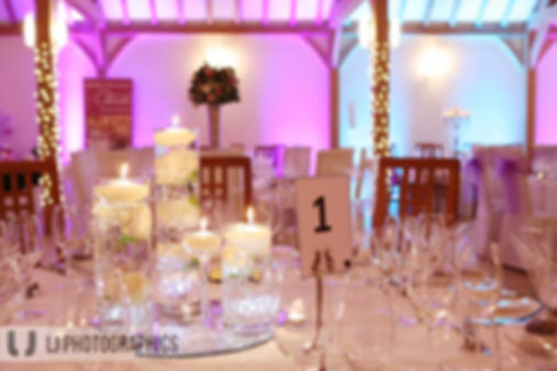 Pink and teal Uplighting at Rivervale Barn in Hampshire
