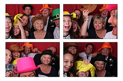 Guests enjoying a photo booth at a wedding in berkshire