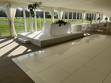 White dance floor and stage.HEIC