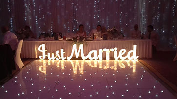 Just married sign for hire in front of head table for a wedding