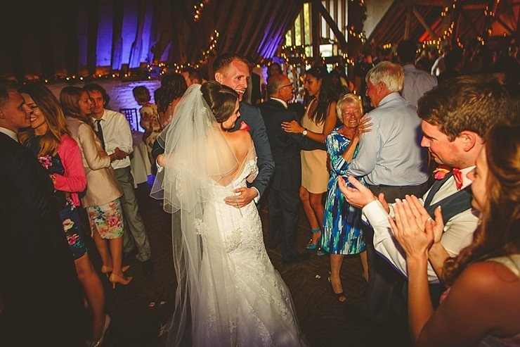 lovely photo of a bride and groom dancing with their guests to the wedding disco at Ufton Court